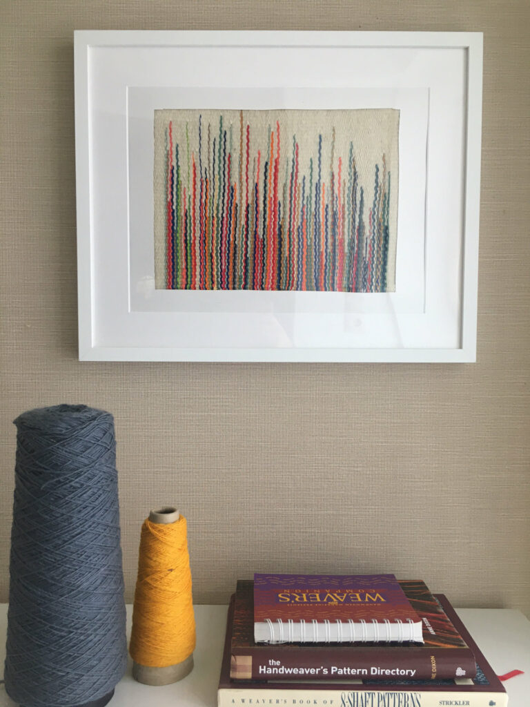 Picture showing a framed result after following our weaving seminars